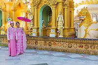 YANGON, MYANMAR -NOVEMBER 25, 2016 : Burmese bride and groom posing with traditional cosutmes Shwedagon Pagoda Yangon (Rangoon) in Myanmar (Burma)