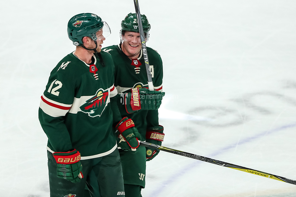 Feb 10, 2018; Saint Paul, MN, USA; Minnesota Wild forward Eric Staal (12) looks on with defenseman Ryan Suter (20) during the third period against the Chicago Blackhawks at Xcel Energy Center. Mandatory Credit: Brace Hemmelgarn-USA TODAY Sports