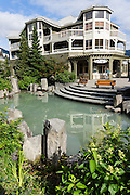 Pedestrian walkways are well landscaped with waterways and art at the Resort Municipality of Whistler, British Columbia, Canada.