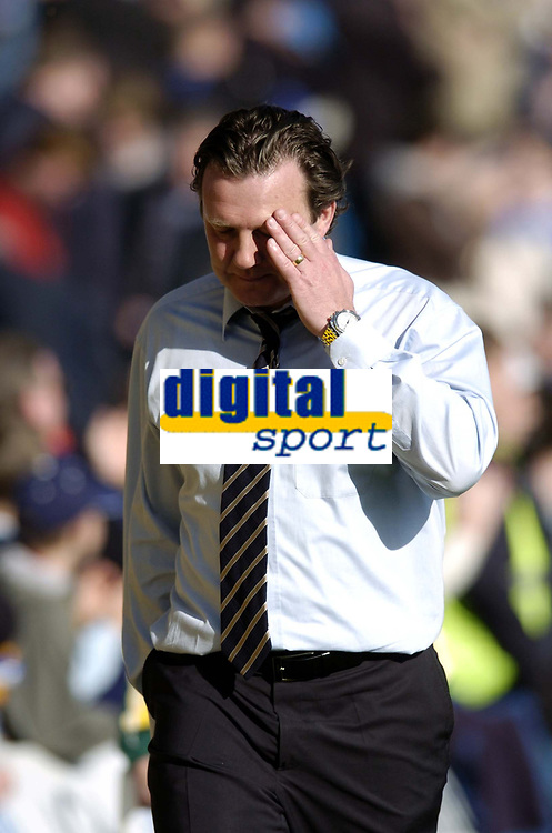 Photo: Olly Greenwood.<br />Gillingham v Huddersfield Town. Coca Cola League 1. 08/04/2006. Huddersfield's manager Peter Jackson looks dejecked after the game.