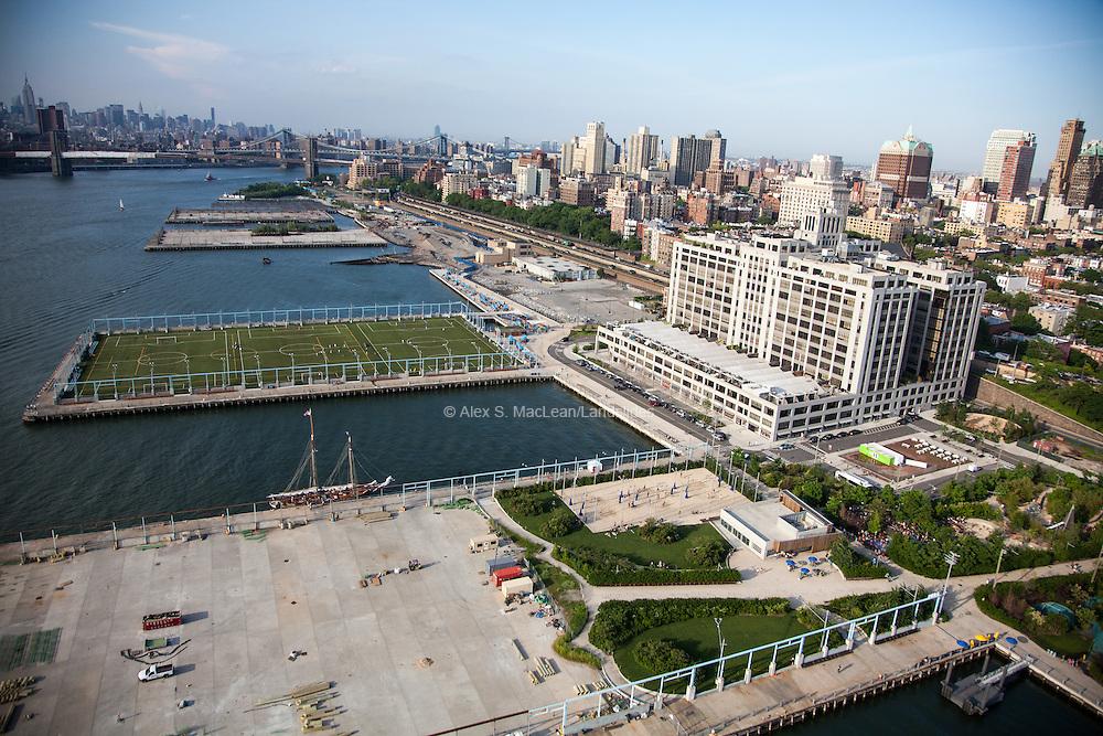 Looking north over the piers of Brooklyn Bridge Park, designed by Michael Van Valkenburgh Associates