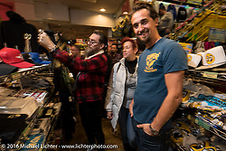 Fabrizio Caoduro or 70's Helmets in Italy Shopping in the Mooneyes store during the Monday night afterparty at Mooneyes Area One after the Mooneyes Yokohama Hot Rod & Custom Show. Yokohama, Japan. December 5, 2016.  Photography ©2016 Michael Lichter.