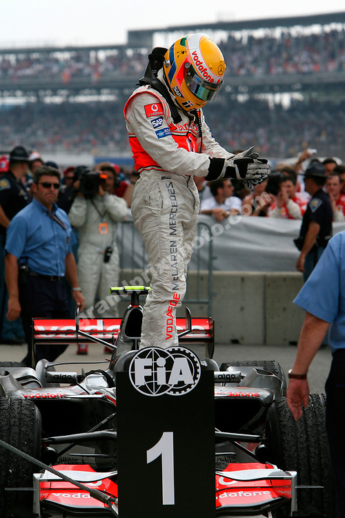 Lewis Hamilton on his McLaren-Mercedes after winning the 2007 United States Grand Prix in Indianapolis. Photo: Grand Prix Photo