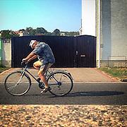 Tired cyclist. #latergram #lysanalabem #lysa #czechrepublic #cyclist #bike #hot #shadow #man #street #public #tropicalweather #heiss #fahrrad #strasse #tschechien