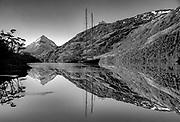 Yacht at anchor, dawn reflection, Tres Brazos, Isla Gordon, Tierra del Fuego, Chile.