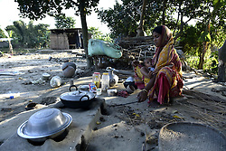 November 3, 2018 - Guwahati, Assam, India - An women with her child cooking in an open air on Saturday in Barpeta of Assam, India on November 03, 2018.  Barpeta District administration and police carried out an eviction drive against  Around 70 illegally constructed houses at Ganak Kuchi reserve following express orders from Assam Chief Minister Sarbananda Sonowal on Tuesday, 2 Oct. 2018. (Credit Image: © David Talukdar/NurPhoto via ZUMA Press)
