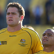 Australian captain James Horwill, (left) and Will Genia during the teams national anthems before the South Africa V Australia Quarter Final match at the IRB Rugby World Cup tournament. Wellington Regional Stadium, Wellington, New Zealand, 9th October 2011. Photo Tim Clayton...