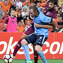 BRISBANE, AUSTRALIA - NOVEMBER 19: Rhyan Grant of Sydney and Thomas Broich of the Roar compete for the ball during the round 7 Hyundai A-League match between the Brisbane Roar and Sydney FC at Suncorp Stadium on November 19, 2016 in Brisbane, Australia. (Photo by Patrick Kearney/Brisbane Roar)