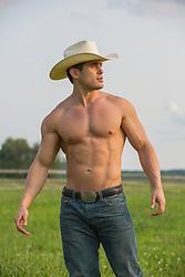 shirtless muscular cowboy outdoors