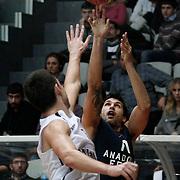 Anadolu Efes's Cenk Akyol (R) during their Turkish Basketball league derby match Besiktas between Anadolu Efes at the BJK Akatlar Arena in Istanbul Turkey on Saturday 31 December 2011. Photo by TURKPIX