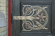 """Details of restored metalwork by Benham & Froud on a door of the old Abbey Mills Pumping Station (Station A). Located in Abbey Lane, London E15, the building is a sewerage pumping station, designed by engineer Joseph Bazalgette, Edmund Cooper, and architect Charles Driver, it was built between 1865 and 1868 after an outbreak of cholera in 1853 and """"The Big Stink"""" of 1858. It was designed in a cruciform plan, with an elaborate Byzantine style, described as The Cathedral of Sewage. The pumps raise the sewage in the London sewerage system between the two Low Level Sewers and the Northern Outfall Sewer, which was built in the 1860s to carry the increasing amount of sewage produced in London away from the centre of the city."""