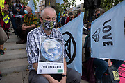 Meditating protesters at Extinction Rebellion demonstration on 3rd September 2020 in London, United Kingdom. With government resitting after summer recess, the climate action group has organised two weeks of events, protest and disruption across the capital. Extinction Rebellion is a climate change group started in 2018 and has gained a huge following of people committed to peaceful protests. These protests are highlighting that the government is not doing enough to avoid catastrophic climate change and to demand the government take radical action to save the planet.