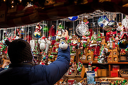 © Licensed to London News Pictures. 17/12/2015. Chicago, USA. Vendors from Europe, including sellers from Germany and Poland, present their festive wares at the annual Christkindl market in Daley Plaza in the heart of downtown.  Inspired by the Christkindlesmarkt in Nuremberg, Germany, which began in 1545, the annual market provides Chicagoans the opportunity to buy unique handmade Christmas gifts. Photo credit : Stephen Chung/LNP