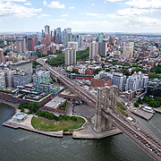 Aerial footage shows a Brooklyn Bridge that looks virtually empty with closed businesses and limited traffic due to the Coronavirus (Covid-19) outbreak along with the continuing protests due to the police killing of George Floyd on Monday, June 1, 2020 in New York City.  Nonessential businesses have been closed and large gatherings have been banned across the state since March 22 under an emergency order issued by Governor Cuomo and an 11 p.m. curfew was ordered by NY Mayor Bill de Blasio amid the Floyd protests. (Alex Menendez via AP)
