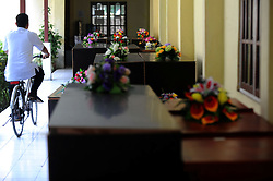 A man rides a bicycle past coffins of victims of AirAsia Flight QZ8501 at a hospital in Pangkalan Bun, Indonesia. Jan. 4, 2015. An Indonesian pilot taking part in the multinational search operation said here on Sunday that three more bodies were found in AirAsia crash site off Borneo coast. EXPA Pictures © 2015, PhotoCredit: EXPA/ Photoshot/ Agung Kuncahya B.<br /> <br /> *****ATTENTION - for AUT, SLO, CRO, SRB, BIH, MAZ only*****