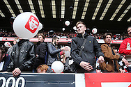Charlton Athletic fans protesting by throwing balloons and black and white beach balls to disrupt the match being kicked off.  Skybet football league championship match, Charlton Athletic v Brighton & Hove Albion at The Valley  in London on Saturday 23rd April 2016.<br /> pic by John Patrick Fletcher, Andrew Orchard sports photography.