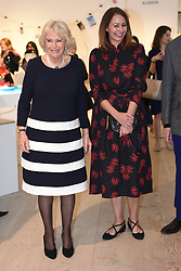 The Duchess of Cornwall (left) with Chief Executive of the British Fashion Council Caroline Rush, during a visit to London Fashion Week at the BFC Show Space, London.