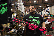 December 16th, Custom painted AR 15 assault riffle on display at a<br /> gun show at the Pontchartrain Center in Kenner Louisiana held by Great Southern Gun and Knife Shows L.L. C. . John Gauthier owner of On Target, painted the gun with skulls on it for his eleven year old daughter. Gun sales have increased since the school shooting massacre in Sandy Hook Connecticut, especially AR 15s  ( one of the guns used by Adam Lanza, the killer) as gun owners fear new legislature will soon regulate sales of such guns.