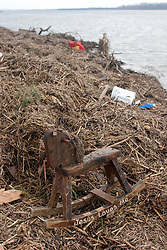 25 Sept, 2005.  Cameron, Louisiana.  Hurricane Rita aftermath. <br /> A childs' hobby horse lies washed up with the words 'Jesus loves me' written on the runners. <br /> Photo; ©Charlie Varley/varleypix.com