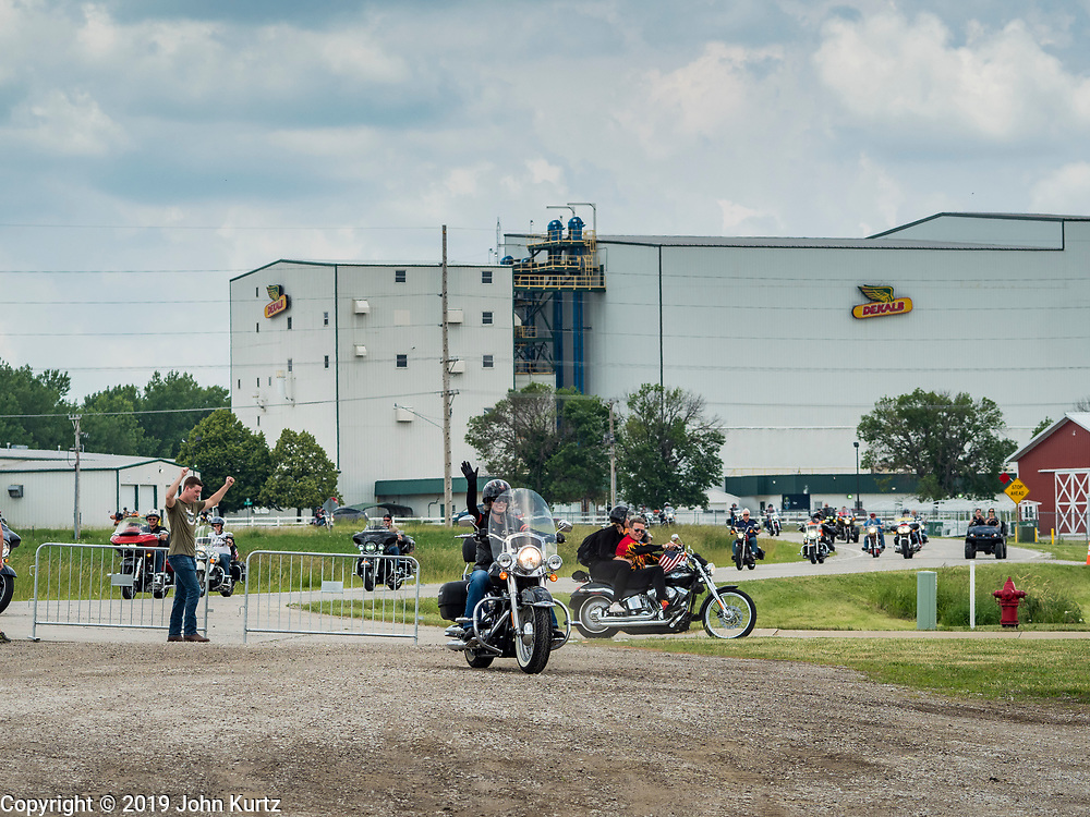 """15 JUNE 2019 - BOONE, IOWA: US Senator JONI ERNST (center) waves as she arrives at """"Joni's Roast and Ride"""", a motorcycle ride / barbecue fund raiser she hosts. Ernst, Iowa's junior US Senator, kicked off her re-election campaign during the """"Roast and Ride"""", an annual fund raiser and campaign event she has held since originally being elected to the US Senate in 2014.     PHOTO BY JACK KURTZ"""
