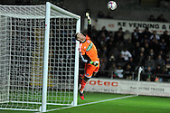 Middlesborough goalkeeper Jason Steele sees a free kick taken by Swansea city's Jonathan de Guzman hit the crossbar. Capital one cup, quarter final, Swansea city v Middlesbrough at the Liberty Stadium in Swansea, South Wales on Wednesday 12th Dec 2012. pic by Andrew Orchard, Andrew Orchard sports photography,