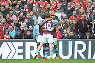 Christian Benteke of Aston Villa  (l) celebrates  after scoring his sides first goal of the game with Jack Grealish of Aston Villa and Fabian Delph, the Aston Villa captain  to make it 1-1. The FA Cup, semi final match, Aston Villa v Liverpool at Wembley Stadium in London on Sunday 19th April 2015.<br /> pic by John Patrick Fletcher, Andrew Orchard sports photography.