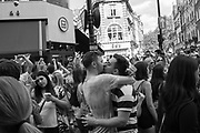 Football fans mixed up with some Gay Pride attendeees, after England won their game against Sweded,  2018, Soho, London. 7 July 2018