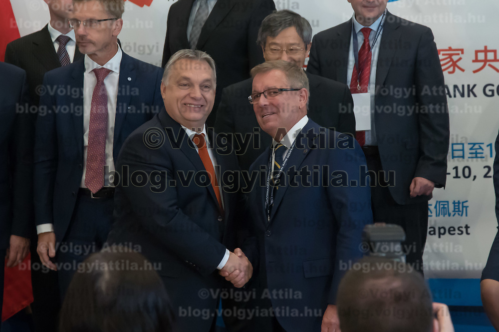 Hungarian Prime Minister Viktor Orban (L) and Gang Yi (R) governor of People's Bank of China shake hands after the opening ceremony of the 16+1 China-CEEC Central Bank Governors' Meeting in Budapest, Hungary on Nov. 9, 2018. ATTILA VOLGYI