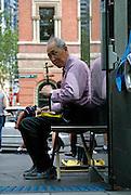 Elderly busker playing a Chinese Erhu (a two-stringed fiddle or violin). Sydney, Australia