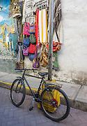 Mountain bike by colorful handbags in Huaraz, in the Santa Valley (Callejon de Huaylas), Ancash Region, Peru, Andes Mountains, South America.