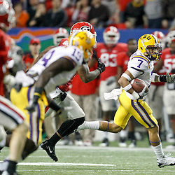Dec 3, 2011; Atlanta, GA, USA; LSU Tigers cornerback Tyrann Mathieu (7) returns a punt against the Georgia Bulldogs during the second half of the 2011 SEC championship game at the Georgia Dome.  Mandatory Credit: Derick E. Hingle-US PRESSWIRE