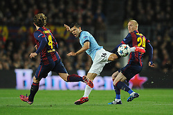 Manchester City's Sergio Aguero is tackled by Barcelona's Jeremy Mathieu - Photo mandatory by-line: Dougie Allward/JMP - Mobile: 07966 386802 - 18/03/2015 - SPORT - Football - Barcelona - Nou Camp - Barcelona v Manchester City - UEFA Champions League - Round 16 - Second Leg