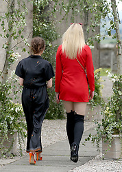 Actress Sophie Turner (right) and Maisie Williams arrive at Rayne Church, Kirkton of Rayne in Aberdeenshire, for the wedding ceremony of Game Of Thrones stars Kit Harington and Rose Leslie.