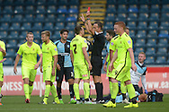 Referee Darren Deadman gives a red card/sends off Carl Magnay of Hartlepool United for a foul on Ryan Sellers of Wycombe Wanderers. Skybet football league two match, Wycombe Wanderers v Hartlepool Utd at Adams Park in High Wycombe, Bucks on Saturday 5th Sept 2015.<br /> pic by John Patrick Fletcher, Andrew Orchard sports photography.
