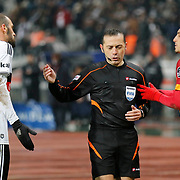 Referee's Cuneyt Cakir (C) during their Turkish superleague soccer match Besiktas between Galatasaray at Ataturk Olimpiyat Stadium in Istanbul Turkey on Sunday 04 January 2015. Photo by Aykut AKICI/TURKPIX