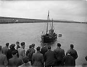 """31/08/1953<br /> 08/31/1953<br /> 31 August 1953 <br /> Rescue at sea by trawler """"Uncle Pat"""" of three Co. Dublin men who spent a night in a row boat at Dun Laoghaire. The trawler returning to port with the row boat in tow."""
