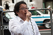 Makoto Sakurai,founder and leader of Zaitokukai, anti-foreigner hate group talks outside  Yasukuni Shrine, Kudashita, Tokyo, Japan Monday August 15th 2011. On August 15th every year people gather at Yasukuni Shrine to commemorate the end of the Pacific War. Notionally a call for remembrance and continued peace it is also a Mecca for right wing nationalist and the paramilitary Uyoku dantai.