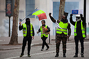 """Mcc0086782 . Daily Telegraph<br /> <br /> DT News<br /> <br /> A """"gilet jaune"""" runs from tear gas with his dog under his arm .<br /> <br /> Scenes on the on Ave de Freidland and Blvd Hausmann as protests turn violent in Paris for another weekend .<br /> <br /> Paris 8 December  2018"""