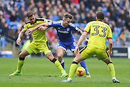 Cardiff City's Joe Ralls (c) battles with Rotherham's Joe Mattock (l) and Richard Smallwood (r). EFL Skybet championship match, Cardiff city v Rotherham Utd at the Cardiff city stadium in Cardiff, South Wales on Saturday 18th February 2017.<br /> pic by Carl Robertson, Andrew Orchard sports photography.