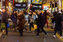 London, December 24 2017. Crowds grow in London's west end on Christmas eve as last minute shoppers hunt for gifts. PICTURED: Shoppers head for the tube or to grab some last minute presents as the shopping day draws to an end at Oxford Circus. © SWNS
