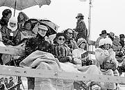Anthony Marangos,Betty Kenward and Zoe Richmond-Watson brave the weather. Cartier Polo. St. Moritz. January 1985. .© Copyright Photograph by Dafydd Jones 66 Stockwell Park Rd. London SW9 0DA Tel 020 7733 0108 www.dafjones.com