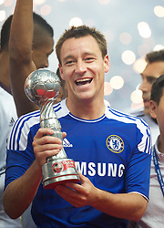 24.07.2011, Rajamangala National Stadium, Bangkok, THA, Chelsea FC Asia Tour, Thailand All Star XI vs Chelsea FC, im Bild // Chelsea's John Terry celebrates with a trophy after beating a Thailand All Star XI 4-0 at the Rajamangala National Stadium in Bangkok on the club's preseason Asia Tour, EXPA Pictures © 2011, PhotoCredit: EXPA/ Propaganda/ D. Rawcliffe *** ATTENTION *** UK OUT!