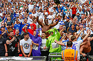 Tranmere Rovers football fans, football supporters celebrate after the EFL Sky Bet League 2 Play Off Final match between Newport County and Tranmere Rovers at Wembley Stadium, London, England on 25 May 2019.