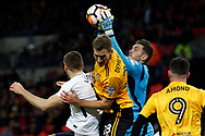 Joe Day , the goalkeeper of Newport County (1R) catches the ball from a Tottenham corner kick. The Emirates FA Cup, 4th round replay match, Tottenham Hotspur v Newport County at Wembley Stadium in London on Wednesday 7th February 2018.<br /> pic by Steffan Bowen, Andrew Orchard sports photography.