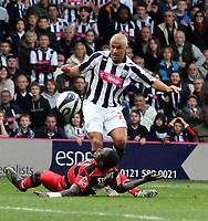 Photo: Mark Stephenson.<br /> West Bromwich Albion v Queens Park Rangers. Coca Cola Championship. 30/09/2007.West Brom's Kevin Phillips gets the better of Qpr's Damion Stewart