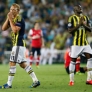 Fenerbahce's Moussa Sow (R) and Dirk Kuijt (L) during the UEFA Champions League Play-Offs First leg soccer match Fenerbahce between Arsenal at Sukru Saracaoglu stadium in Istanbul Turkey on Wednesday 21 August 2013. Photo by /TURKPIX