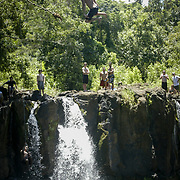 Jumping from waterfall at end of hike in Maui.