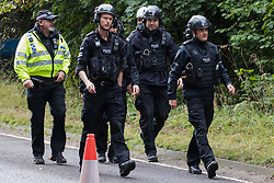 Thames Valley Police officers facilitate works by National Eviction Team (NET) enforcement agents to evict environmental activists opposed to the HS2 high-speed rail link from Wendover Active Resistance (WAR) camp on 10th October 2021 in Wendover, United Kingdom. WAR camp, which contains tree houses, tunnels, a cage and a 15-metre tower, is currently the largest of the protest camps set up by Stop HS2 activists along HS2's Phase 1 route between London and Birmingham.