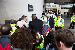 London, UK. 21st December, 2018. Environmental campaigners from Extinction Rebellion try to prevent staff entering and leaving Broadcasting House during a protest against the lack of coverage by the BBC of the climate change crisis.