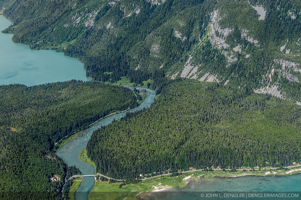 The Chilkoot River corridor between Chilkoot Lake (upper left) and Lutak Inlet of the Lynn Canal (bottom right) is a popular sport fishing spot and a culturally important Tlingit historic site. The river area is also popular with grizzly bears who also come for the salmon who spawn in the Chilkoot River. While this concentration of bears makes for exciting bear viewing for visitors, the narrow corridor in which humans and bears must pass can lead to dangerous encounters. The Alaska Legislature has approved $1 million for a bear-viewingplatform aimed at reducing encounters between bears and visitors tothe scenic corridor. This area is part of the popular Chilkoot Lake State Recreation Site. In the upper reaches of the Chilkoot River Valley (not pictured) there have been proposals to dam the outlet of Connelly Lake, a high alpine lake above the Chilkoot River, for a hydroelectric project. Environmental concerns include the impact construction and project operation would have on fish spawning and rearing habitat (water turbidity issues), and bald eagles. Alaska Power and Telephone announced in June 2013 that it was putting the project on hold citing difficulty securing funding from the Alaska Energy Authority and the lack of community support. Despite these setbacks AP&T says that it not abandoning pursuing the project. In early September 2013, the Haines Borough announced that it was exploring possibly filing for a preliminary permit now that the project was no longer being pursued by AP&T.